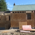 8) Closing in the two additions with standard OSB sheathing
