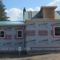 9) Roof system is in place, additions are covered with TYPAR house wrap, doors and windows are insta