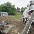 4) Concrete footings being poured as per drawings